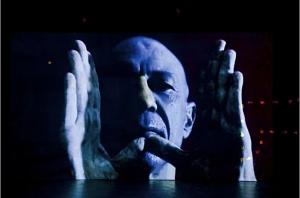 Michele Zaza, Lo spazio del respiro, 2012, videoinstallazione, due video loop, molliche di pane, tempera su parete, dettaglio, Galleria Bianconi, Milano arte